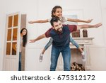 happy father piggybacking cute... | Shutterstock . vector #675312172