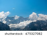 paragliding over the snow... | Shutterstock . vector #675327082