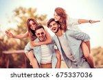 group of friends enjoying... | Shutterstock . vector #675337036