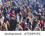 defocused picture of crowd of... | Shutterstock . vector #675349192