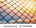 wire fence or metal net on... | Shutterstock . vector #675349486