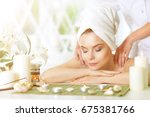 girl lying down on a massage bed | Shutterstock . vector #675381766