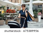 mother with baby carriage... | Shutterstock . vector #675389956
