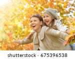 mother and daughter outdoors | Shutterstock . vector #675396538