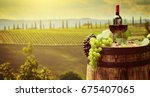 red wine bottle and wine glass... | Shutterstock . vector #675407065