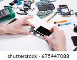 electronics repair service.... | Shutterstock . vector #675447088