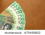 group of 100 dollar australian... | Shutterstock . vector #675450832