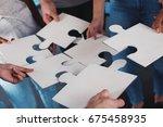 team of businessmen work... | Shutterstock . vector #675458935