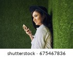 charming young chinese hipster... | Shutterstock . vector #675467836