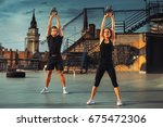 young couple exercising on the... | Shutterstock . vector #675472306