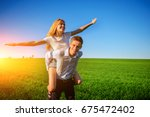 smiling man is holding on his... | Shutterstock . vector #675472402