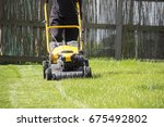 lawn mower cutting green grass... | Shutterstock . vector #675492802