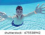 teenage boy  diving underwater... | Shutterstock . vector #675538942