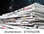newspapers folded and stacked... | Shutterstock . vector #675556258