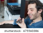man talking on the phone with... | Shutterstock . vector #675560386