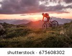 male mountainbiker at sunset in ... | Shutterstock . vector #675608302