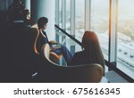 two ladies sitting on armchairs ... | Shutterstock . vector #675616345