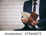 businessman having dollar money ... | Shutterstock . vector #675646075
