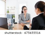 Small photo of beauty attractive business woman listening professional female sales worker explaining new cooperation scheme and introduce deal contract content.