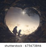Small photo of Silhouette mother Mary and father Joseph looking Jesus born in birth manger on Christmas Eve - 3d illustration