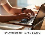hands of person typing on... | Shutterstock . vector #675711292