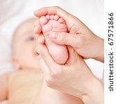 Masseur Massaging Little Baby's ...