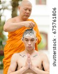 Small photo of BANGKOK, THAILAND - JUNE 11, 2017 : Unidentified man are doing shaving to ordain Buddhist monks. He sat with his hands on the chair and the elders were the shakers on Jun11, 2017 in Bangkok, Thailand.