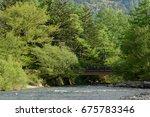 bridge on the water | Shutterstock . vector #675783346