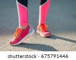 pink sneakers in the sunlight | Shutterstock . vector #675791446