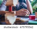 businesswoman domino picked... | Shutterstock . vector #675795562