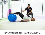 personal trainer is correcting