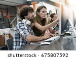 co workers in office working on ...   Shutterstock . vector #675807592