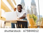 expressive positive guy making... | Shutterstock . vector #675844012