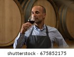 winemaker smelling a glass of...   Shutterstock . vector #675852175