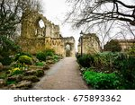 an entrace to the ruined abbey... | Shutterstock . vector #675893362