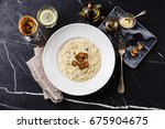 risotto with black truffle on... | Shutterstock . vector #675904675