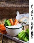 mug of fresh blue cheese garlic ...   Shutterstock . vector #675907696