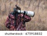 animal photographer. photo...   Shutterstock . vector #675918832