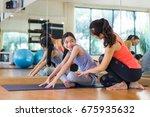 beautiful woman teacher helping ... | Shutterstock . vector #675935632