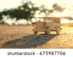 old wooden toy car on the road...   Shutterstock . vector #675987706