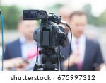 press conference. filming media ... | Shutterstock . vector #675997312
