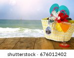 beach objects on wooden table.... | Shutterstock . vector #676012402