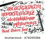 brush script font with doodle... | Shutterstock .eps vector #676040386