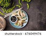 chinese dumplings on plate ...   Shutterstock . vector #676049476