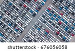 Aerial view new car lined up in the port for import and export business logistic to dealership for sale, Automobile and automotive car parking lot for commercial business  industry. - stock photo