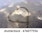 Hand Writing Heart Symbol On...