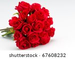 Stock photo bouquet of artificial red roses isolated space for copy in the side 67608232