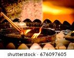 incense stick burning thai...   Shutterstock . vector #676097605