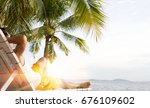 man relaxing on beach on a... | Shutterstock . vector #676109602
