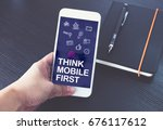 hand holding mobile phone with... | Shutterstock . vector #676117612